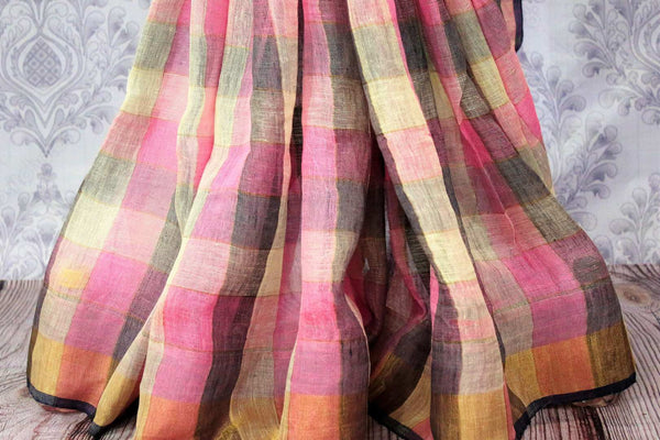 Buy pink and blue checker linen sari online in USA. Choose from a stunning range of stylish Indian woven linen sarees at Pure Elegance store in USA or shop online.-pleats