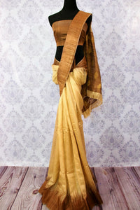 Buy beige matka silk saree with brown border online in USA. Pure Elegance fashion store brings a stunning range of ethnic Indian silk sarees for weddings in USA.-full view