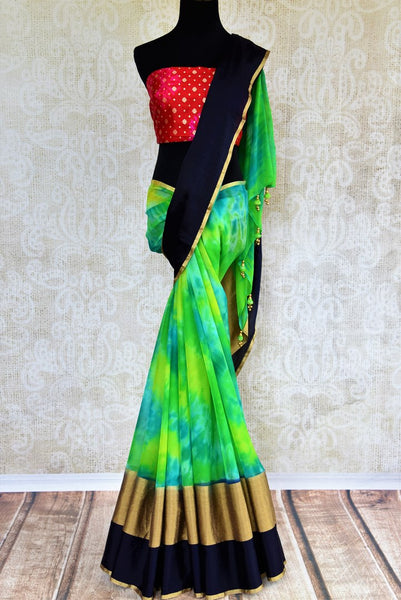 Buy green chiffon saree with shiburi Banarasi silk blouse online in USA. Pure Elegance clothing store brings an exquisite range of Indian chiffon sarees in USA for women. -full view