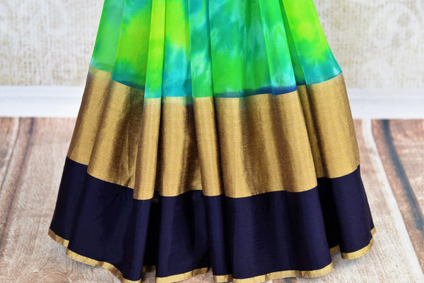 Buy green chiffon saree with shiburi Banarasi silk blouse online in USA. Pure Elegance clothing store brings an exquisite range of Indian chiffon sarees in USA for women. -pleats