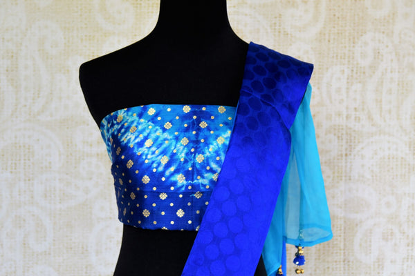 Buy blue chiffon sari with shiburi Banarasi blouse online in USA. Pure Elegance clothing store brings an exquisite range of Indian chiffon sarees in USA for women. -blouse pallu