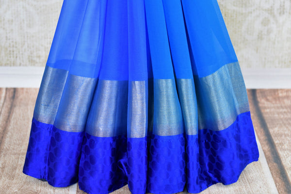 Buy blue chiffon sari with shiburi Banarasi blouse online in USA. Pure Elegance clothing store brings an exquisite range of Indian chiffon sarees in USA for women. -pleats