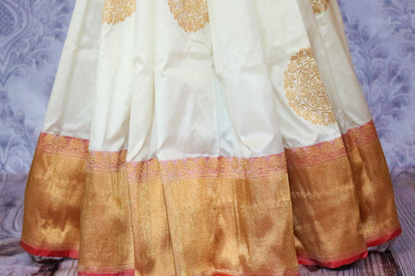 Buy off white Banarasi saree online in USA. Choose from an exquisite range of traditional Indian Banarasi silk sarees at Pure Elegance store in USA or shop online.-pleats