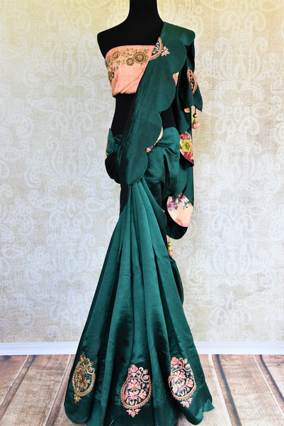 Buy dark green embroidered silk saree online in USA. Pure Elegance store brings an exquisite collection of Indian silk sarees for online shopping in USA. Buy now.-full view