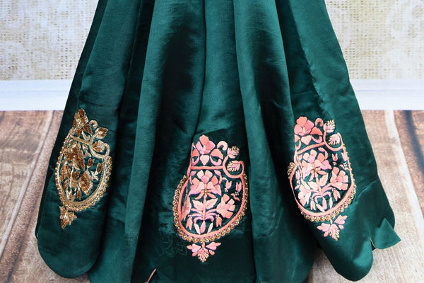 Buy dark green embroidered silk saree online in USA. Pure Elegance store brings an exquisite collection of Indian silk sarees for online shopping in USA. Buy now.-pleats