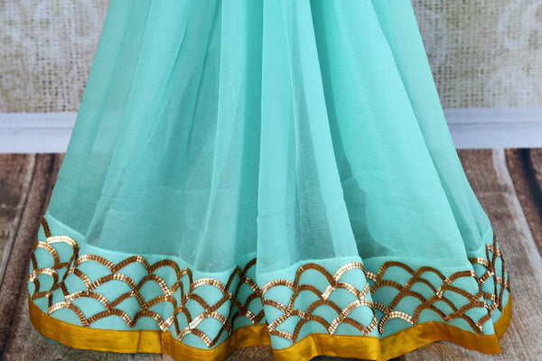Buy sky blue hand embroidery chiffon saree online in USA. Pure Elegance clothing store brings exquisite range of Indian designer sarees for online shopping in USA.-pleats