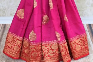 Buy bright pink muga Banarasi saree online in USA. Pure Elegance clothing store brings an exquisite variety of Indian woven Banarasi sarees for online shopping in USA. -pleats