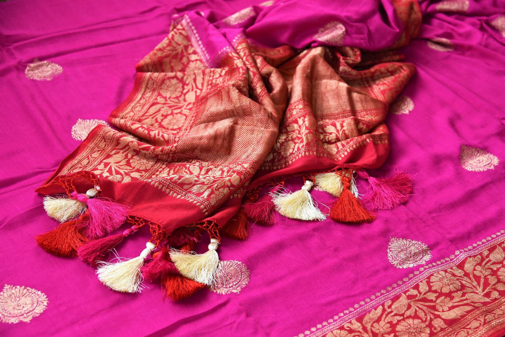 Buy bright pink muga Banarasi saree online in USA. Pure Elegance clothing store brings an exquisite variety of Indian woven Banarasi sarees for online shopping in USA. -details