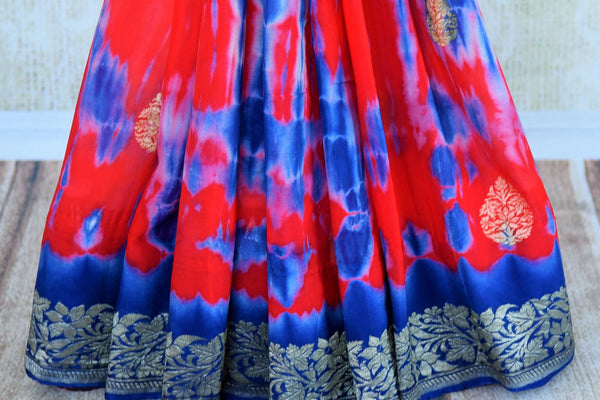 Buy red and blue marble dye georgette Banarasi sari online in USA. Pure Elegance store brings an exquisite range of Indian Banarasi sarees for online shopping in USA. -pleats