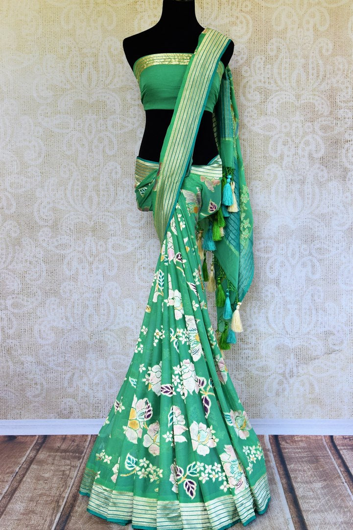Buy green georgette Banarasi saree online in USA. Pure Elegance store brings an exquisite range of Indian designer Banarasi sarees for online shopping in USA. Shop now.-full view