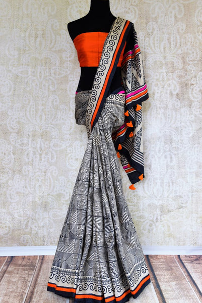Buy black and white printed tussar silk saree online in USA. Pure Elegance store brings an exquisite range of Indian sarees for online shopping in USA. Shop online.-full view