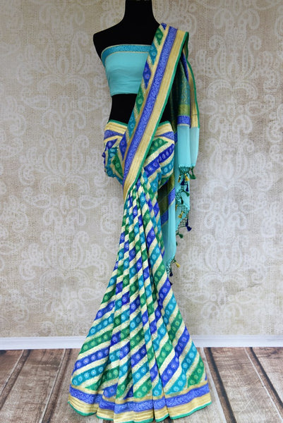Buy blue georgette Banarasi saree online in USA. Pure Elegance clothing store brings an exquisite variety of Indian designer sarees for online shopping in USA. -full view