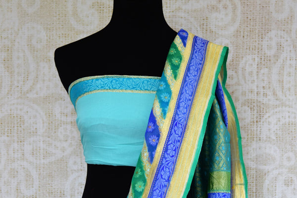 Buy blue georgette Banarasi saree online in USA. Pure Elegance clothing store brings an exquisite variety of Indian designer sarees for online shopping in USA. -blouse pallu