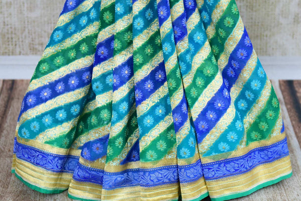 Buy blue georgette Banarasi saree online in USA. Pure Elegance clothing store brings an exquisite variety of Indian designer sarees for online shopping in USA. -pleats