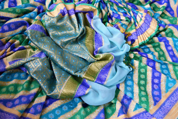 Buy blue georgette Banarasi saree online in USA. Pure Elegance clothing store brings an exquisite variety of Indian designer sarees for online shopping in USA. -details