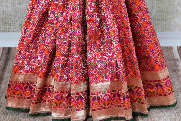 Buy traditional red Banarasi silk ghatchola saree online in USA. Pure Elegance clothing store brings an exquisite variety of Indian Banarasi sarees in USA. Shop online-pleats
