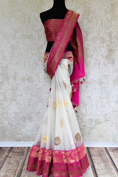 Buy white kora Banarasi saree online with buta in USA. Pure Elegance clothing store brings an exquisite variety of Indian sarees for online shopping in USA. Shop online.-full view