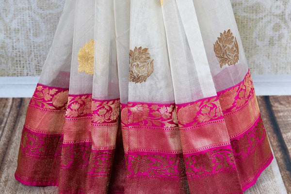 Buy white kora Banarasi saree online with buta in USA. Pure Elegance clothing store brings an exquisite variety of Indian sarees for online shopping in USA. Shop online.-pleats