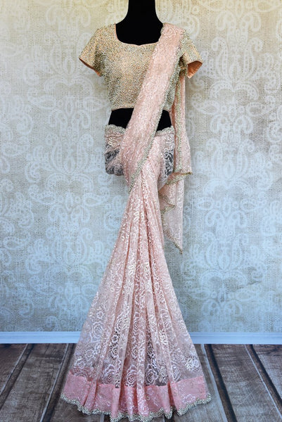 Buy pastel pink pearl embroidered lace sari online in USA. Pure Elegance clothing store brings an exquisite an exquisite variety of Indian designer sarees in USA.-full view