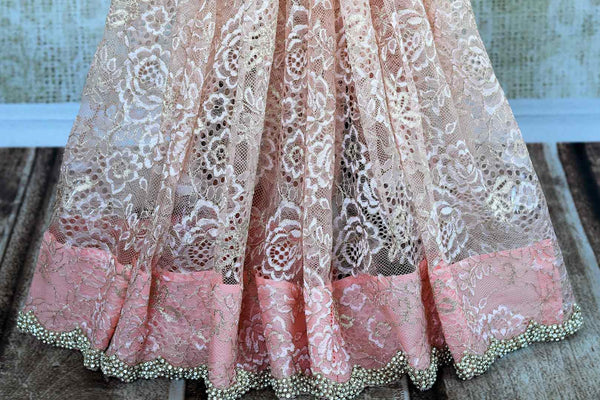 Buy pastel pink pearl embroidered lace sari online in USA. Pure Elegance clothing store brings an exquisite an exquisite variety of Indian designer sarees in USA.-pleats