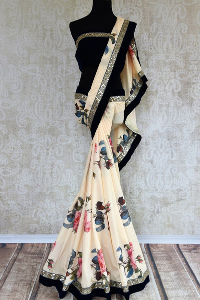 Buy off white floral print muga silk sari online in USA with embroidered border. Pure Elegance fashion store brings an exclusive range of  Indian designer saris in USA.-full view