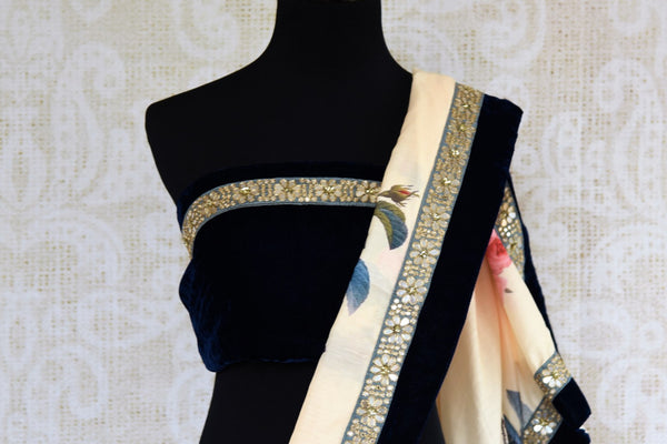 Buy off white floral print muga silk sari online in USA with embroidered border. Pure Elegance fashion store brings an exclusive range of  Indian designer saris in USA.-blouse pallu