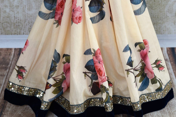 Buy off white floral print muga silk sari online in USA with embroidered border. Pure Elegance fashion store brings an exclusive range of  Indian designer saris in USA.-pleats