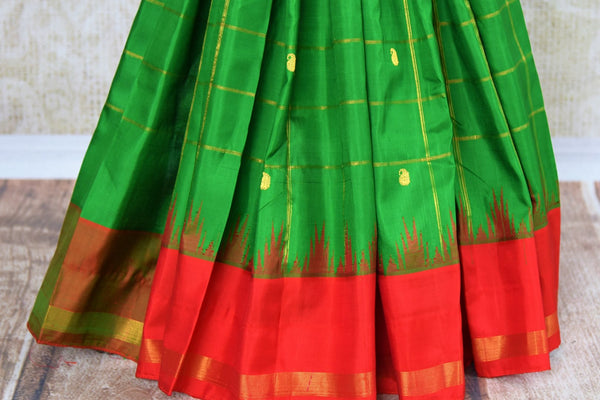 Beautiful green checker gadwal silk saree for online shopping in USA. Explore a range of exquisite Indian silk sarees in USA at Pure Elegance fashion store or shop online. -pleats