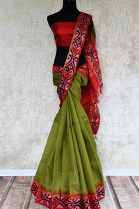 Buy green eri silk saree online in USA with red border. Pure Elegance clothing store brings an exquisite range of Indian silk sarees in USA for women. Shop online.-full view