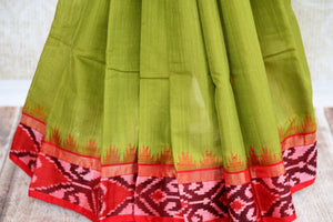 Buy green eri silk saree online in USA with red border. Pure Elegance clothing store brings an exquisite range of Indian silk sarees in USA for women. Shop online.-pleats