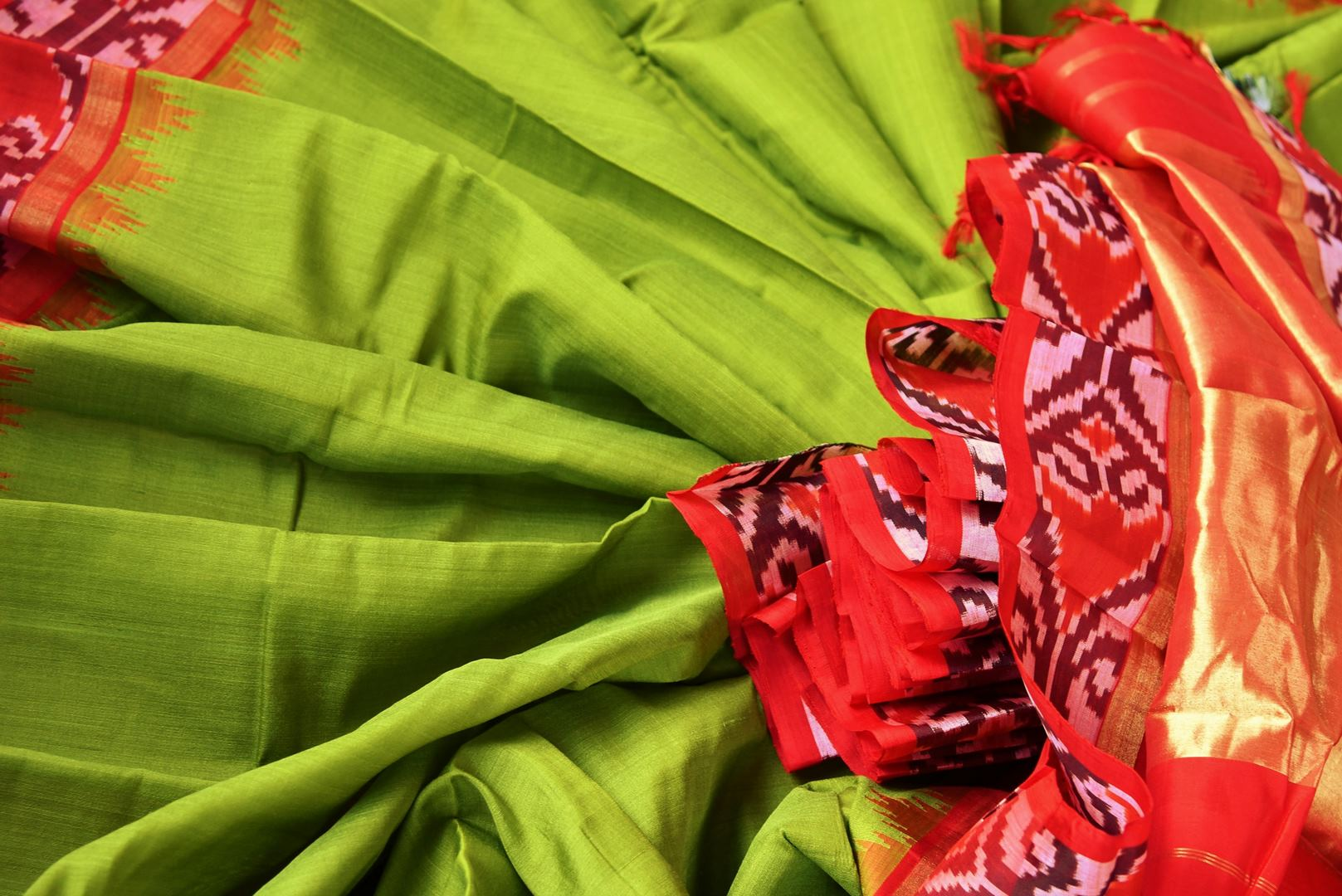 Buy green eri silk saree online in USA with red border. Pure Elegance clothing store brings an exquisite range of Indian silk sarees in USA for women. Shop online.-details