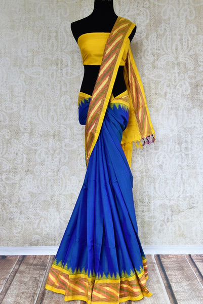 Buy blue eri silk saree online in USA with yellow border. Pure Elegance clothing store brings an exquisite range of Indian silk sarees in USA for women. Shop online.-full view
