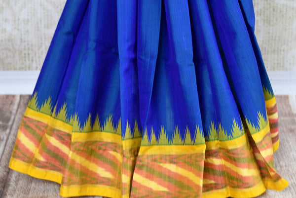 Buy blue eri silk saree online in USA with yellow border. Pure Elegance clothing store brings an exquisite range of Indian silk sarees in USA for women. Shop online.-pleats