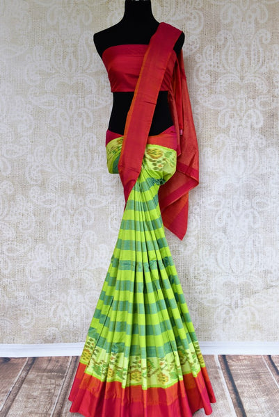 Buy green striped eri silk saree online in USA with pink border. Pure Elegance clothing store brings an exquisite range of Indian silk sarees in USA for women. Shop online.-full view