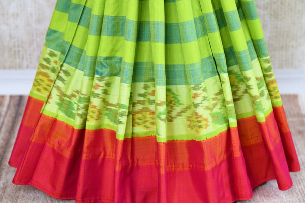 Buy green striped eri silk saree online in USA with pink border. Pure Elegance clothing store brings an exquisite range of Indian silk sarees in USA for women. Shop online.-pleats