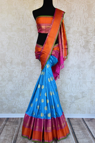 Buy blue Kanjivaram silk saree with ikat weave border online in USA. Pure Elegance clothing store brings an exquisite an exquisite variety of Indian silk sarees in USA.-full view