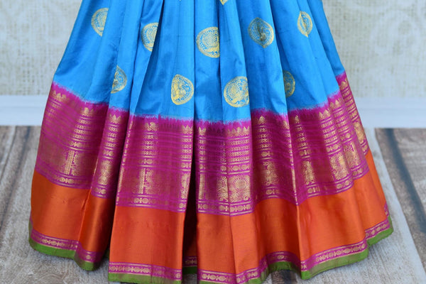 Buy blue Kanjivaram silk saree with ikat weave border online in USA. Pure Elegance clothing store brings an exquisite an exquisite variety of Indian silk sarees in USA.-pleats