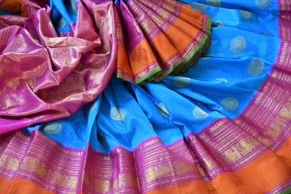 Buy blue Kanjivaram silk saree with ikat weave border online in USA. Pure Elegance clothing store brings an exquisite an exquisite variety of Indian silk sarees in USA.-details