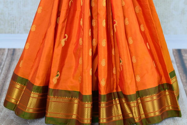 Buy orange paithani silk sari with buta online in USA. Pure Elegance clothing store brings an exquisite range of Indian silk sarees in USA for women. Shop online.-pleats