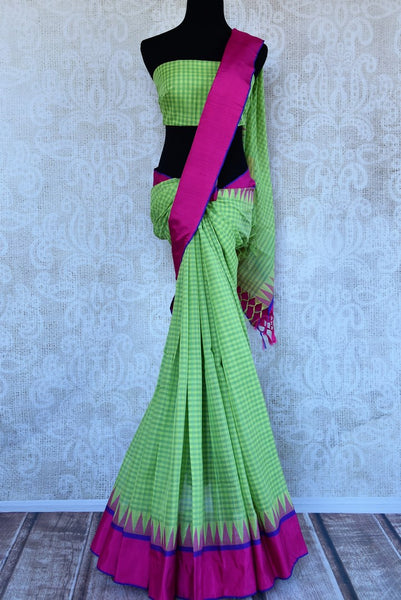 Buy green checked ikat khaddi saree online in USA. Pure Elegance clothing store brings an alluring collection of ethnic Indian ikat saris in USA for women. Shop online.-full view