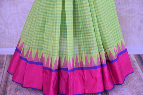 Buy green checked ikat khaddi saree online in USA. Pure Elegance clothing store brings an alluring collection of ethnic Indian ikat saris in USA for women. Shop online.-pleats