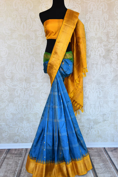 Buy blue gadhwal silk saree with yellow border online in USA. Pure Elegance clothing store brings an exquisite an exquisite variety of Indian silk sarees in USA.-full view