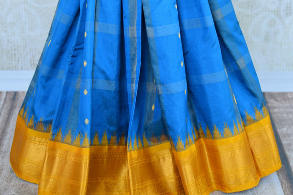Buy blue gadhwal silk saree with yellow border online in USA. Pure Elegance clothing store brings an exquisite an exquisite variety of Indian silk sarees in USA.-pleats