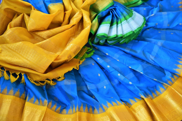Buy blue gadhwal silk saree with yellow border online in USA. Pure Elegance clothing store brings an exquisite an exquisite variety of Indian silk sarees in USA.-details