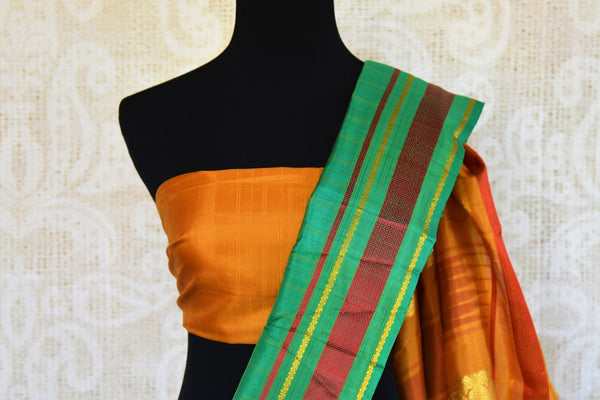 Buy green checker khadi silk saree online in USA. Pure Elegance clothing store brings an exquisite range of Indian woven silk sarees in USA for women. Shop online.-blouse pallu