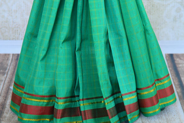 Buy green checker khadi silk saree online in USA. Pure Elegance clothing store brings an exquisite range of Indian woven silk sarees in USA for women. Shop online.-pleats
