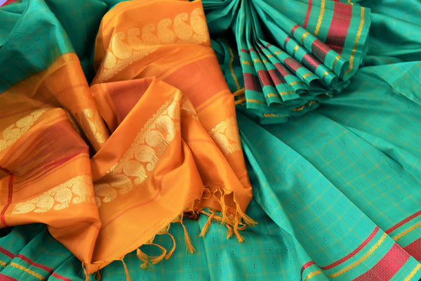 Buy green checker khadi silk saree online in USA. Pure Elegance clothing store brings an exquisite range of Indian woven silk sarees in USA for women. Shop online.-details