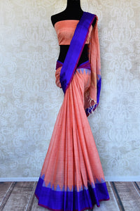 Buy pink ikat khaddi sari online in USA with blue border. Pure Elegance clothing store brings an alluring collection of ethnic Indian ikkat saris in USA for women. -full view