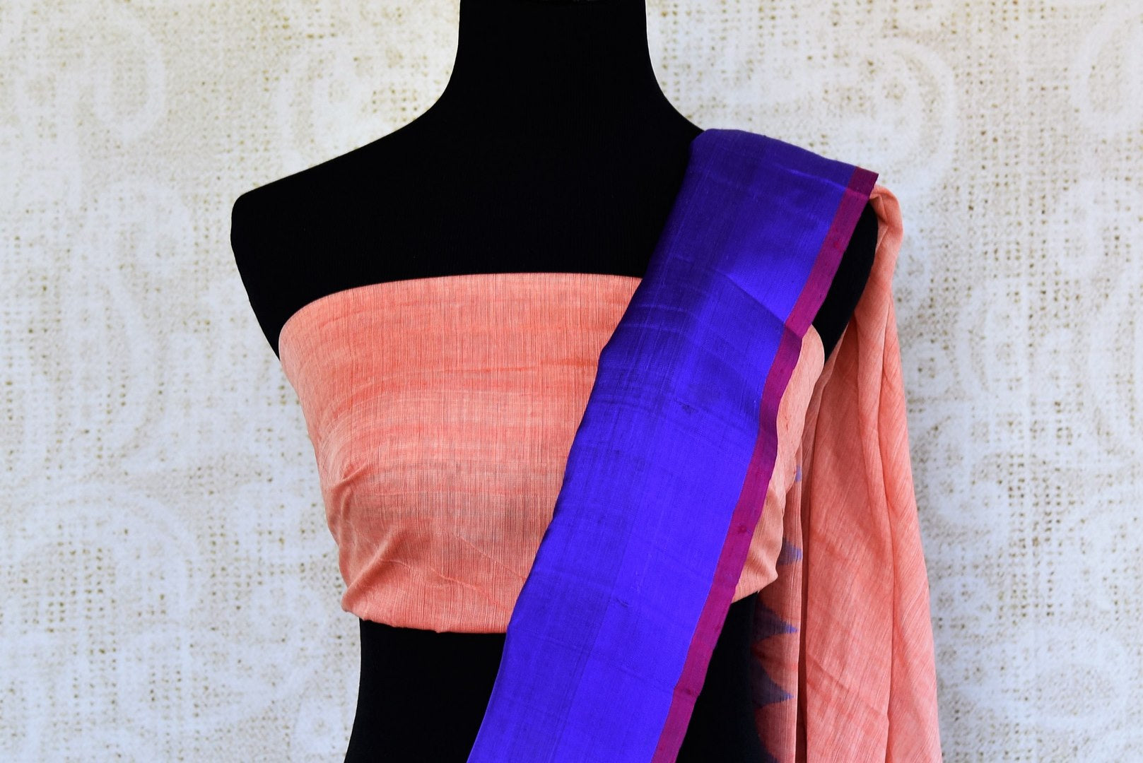 Buy pink ikat khaddi sari online in USA with blue border. Pure Elegance clothing store brings an alluring collection of ethnic Indian ikkat saris in USA for women. -blouse pallu