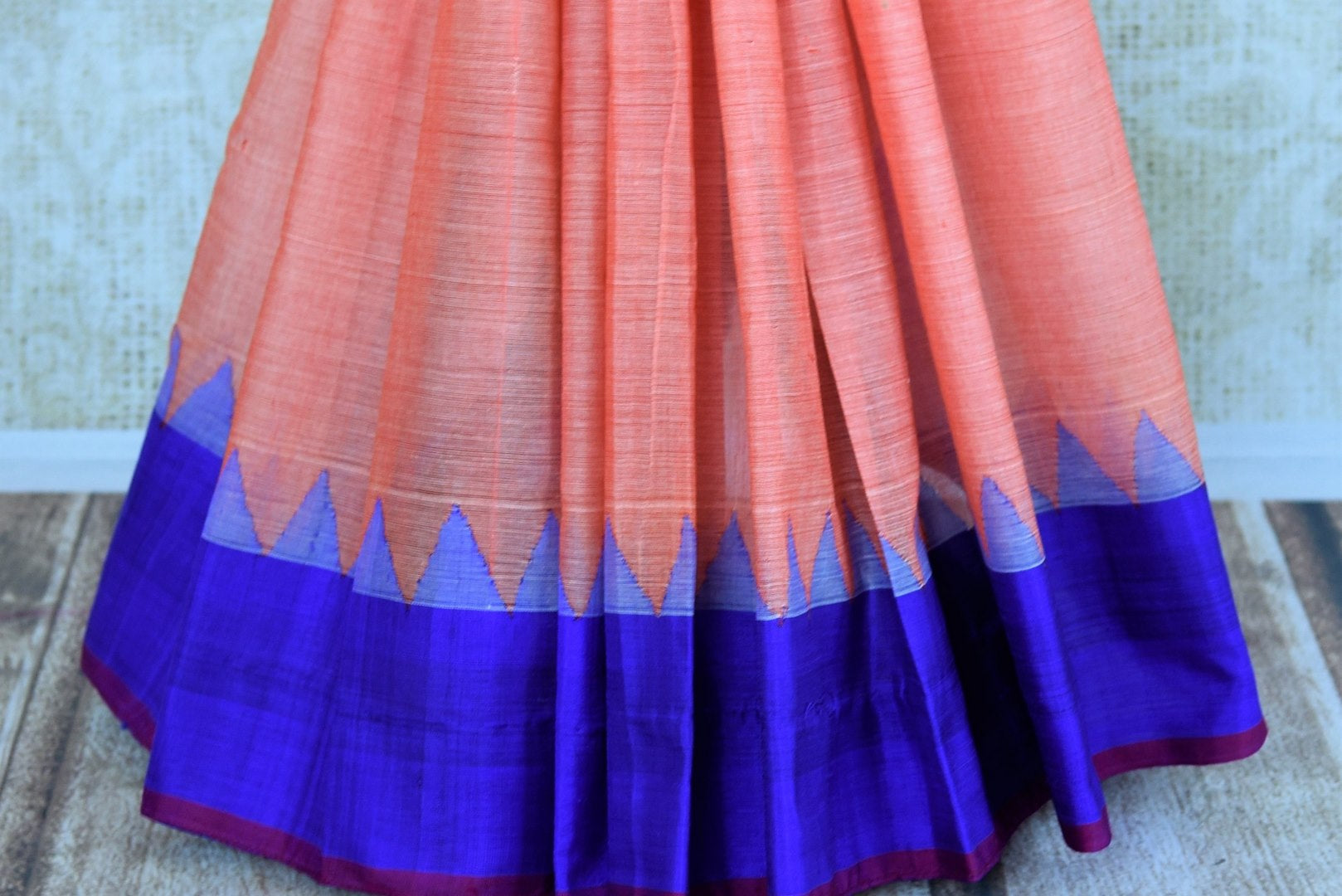 Buy pink ikat khaddi sari online in USA with blue border. Pure Elegance clothing store brings an alluring collection of ethnic Indian ikkat saris in USA for women. -pleats